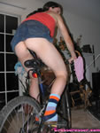 crossdresser on dildo bike
